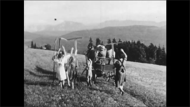 1950s: AUSTRIA: EUROPE: girl kisses family. Family wave goodbye to sister. Girl on cart. View along valley and mountains