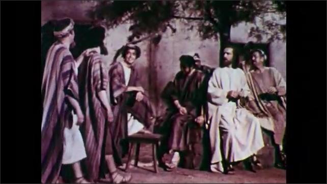 1950s: Close up of man. Dissolve, men walk toward group of men, men hug, sit down.