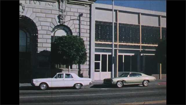 UNITED STATES 1970s: Bank exterior, pan across street.