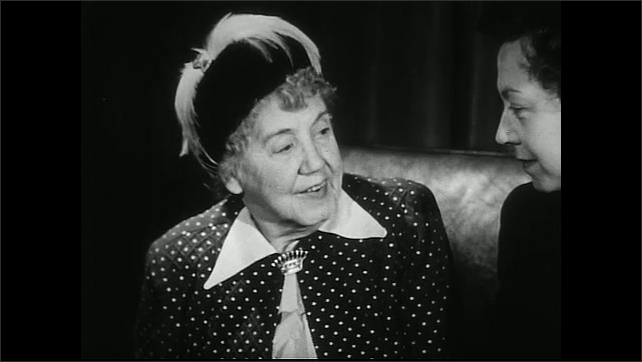 United States 1950s. Man speaks. Old lady with hat speaks.