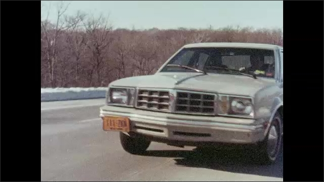 1980s: UNITED STATES: man drives car. Lady looks into lane. Man looks out of window. Man looks for exit.