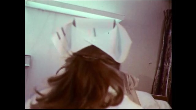 1970s: Nurses lift heavy patient into sitting position on bed. Nurses demonstrate the extremity carry technique. Title screen for extremity carry. Words appear under titles.