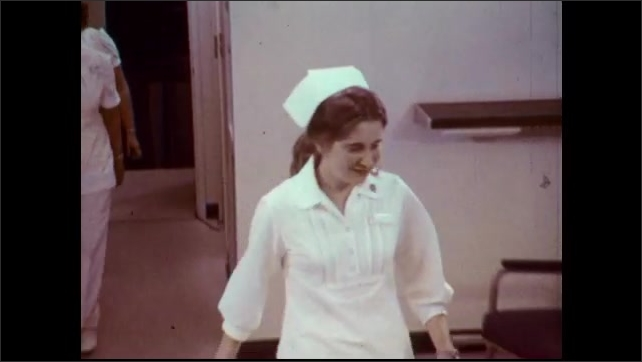 1970s: Four nurses demonstrate the blanket carry technique. Nurse spreads blanket on floor. Nurses lift patient and place them on floor.