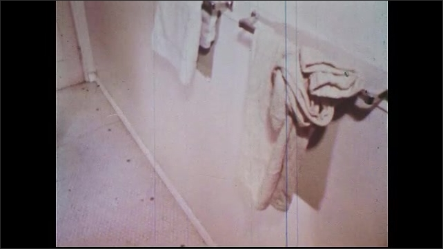1960s: Space heater sets towel on fire. Towel is put safely on towel bar and chair and space heater are removed from the bathroom. Modern, safer heater is a safe distance from