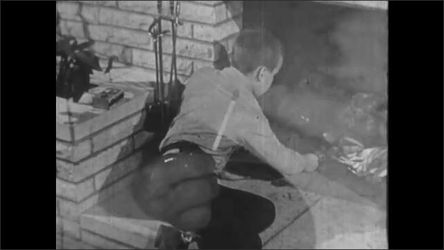1950s: UNITED STATES: boy closes matchbox. Boy strikes match. Close up of match in hand. Fingers break match in half.