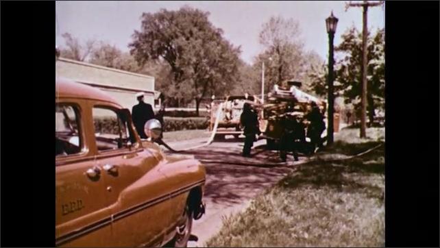 UNITED STATES 1950s : Fire trucks arriving