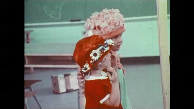 1970s: Girls don hats and dance in front of mirror. Girls play dress up at recess.