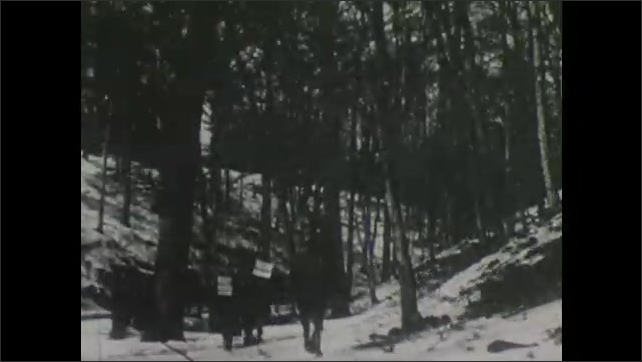 1900s: Man rides on horseback through forest as two men holding signs follow him.