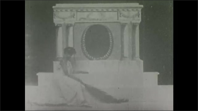 1900s: Woman kneels in front of memorial with picture of Abraham Lincoln on it. Lincoln's portrait on altar is replaced by James Garfield's.