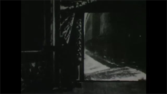 1900s: Man in theater stands in front of screen as train is projected on it. Man gets scared and leaves. Woman and man appear on screen, man returns.