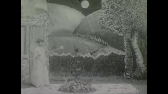 1900s: Theater, moon over trees, woman in angel costume with wings waves wand, something rises from ground.