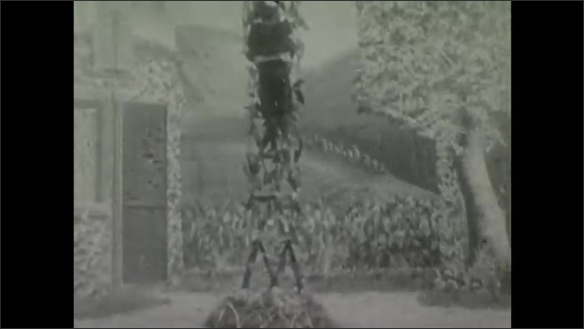 1900s: Theater, woman walks out door, child gestures, looks up, climbs structure. Woman returns, waves hands in air, paces.