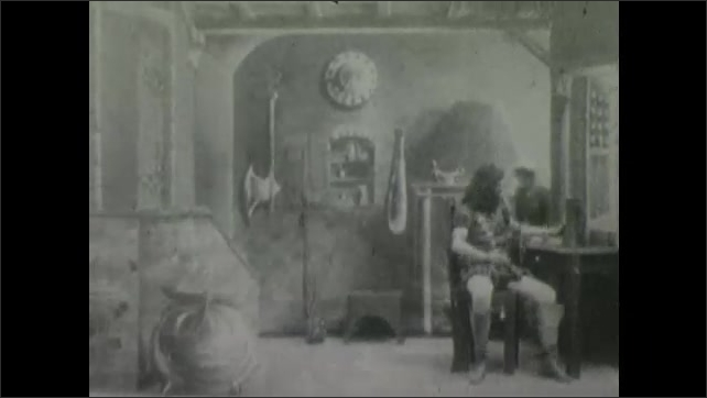 1900s: Theater, soldier sits at table, drinks, woman places platter on table, takes it away. Boy pops out of urn. Woman sets things on table. Man stands, waves arms.