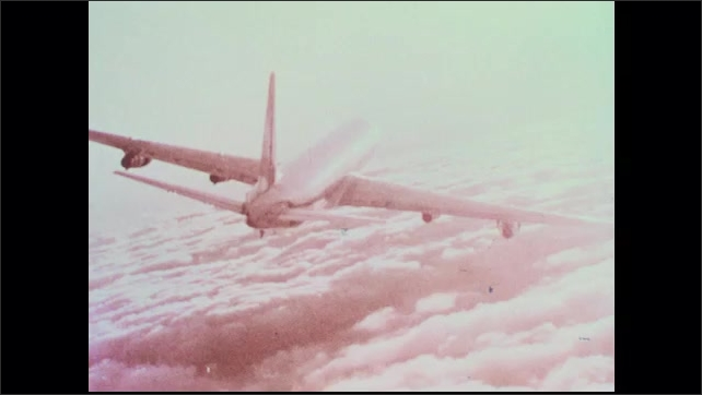 1960s: Eastern Airplanes airplane flies above clouds in the sun.