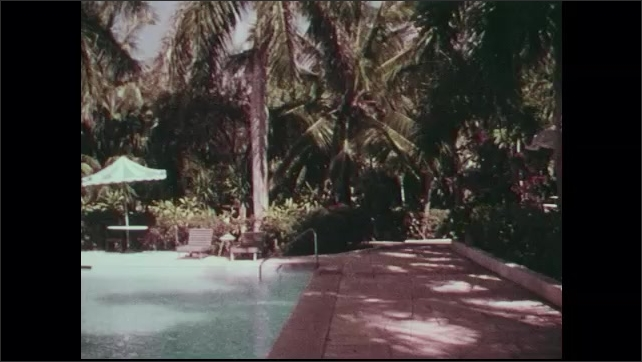 1960s: Aerial view of Eleuthera Island with beaches, lagoons and vegetation. Hotel resort pool and patio.