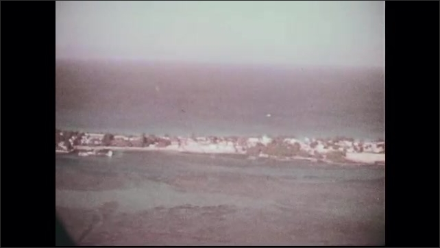 1960s: Aerial view of Bimini Island, including houses and trees.