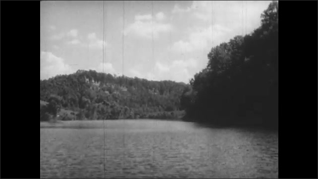 1800s: waters of Ohio River flows past streams, banks and hills covered in lush trees and bushes.