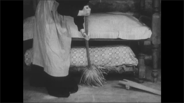1800s: hands caulk wood on boat with paddle and nail. women sweep floor under trundle bed and sew cloth with needle and thread near cabinet in log cabin.