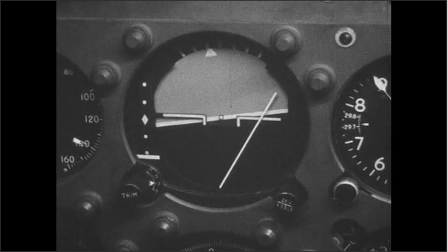 UNITED STATES 1960s: 2 pilots in airplane / close up of airplane balance meter / close up of meters