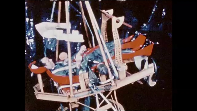 1960s: UNITED STATES: astronauts train in centrifuge. Tumbling space craft simulation. Training missions on ground. Simulation of space flight