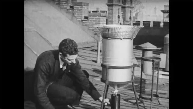 1930s: Man fills rain gauge and measures rain.