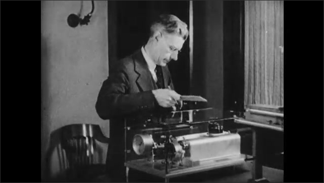 1930s: Recording apparatus records marks. Man writes on paper and walks away.