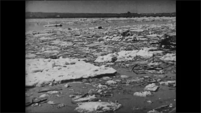 1930s: River flows with snow and ice on it.