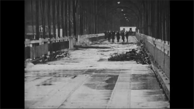 1930s: River floods bridge.
