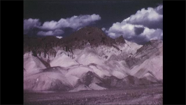 1950s: UNITED STATES: view across desert. Death Valley desert. Mountains and cloud in desert