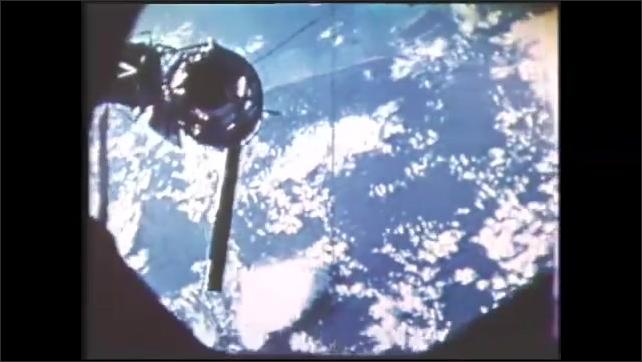 1980s: Spacecraft in orbit.  Earth.  Astronaut plays with liquid.  Two blobs of fluid merge.