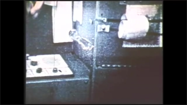 1980s: Space.  Astronaut uses tool to manipulate blob of water.
