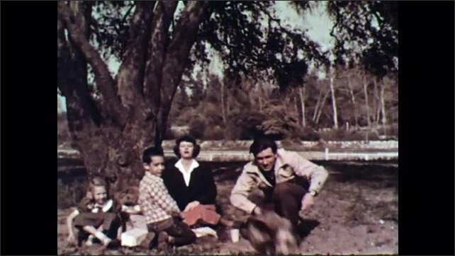 UNITED STATES 1950s : Family playing with dog/ Family clap/ Shot of goat