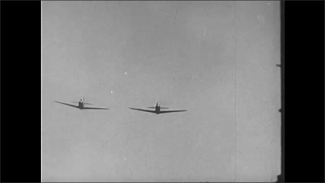1950s: Planes fly through sky, men parachute out of planes. Planes lined up on airfield. P-39 airacobra with nose cannon. Tomahawk plane flies through sky.
