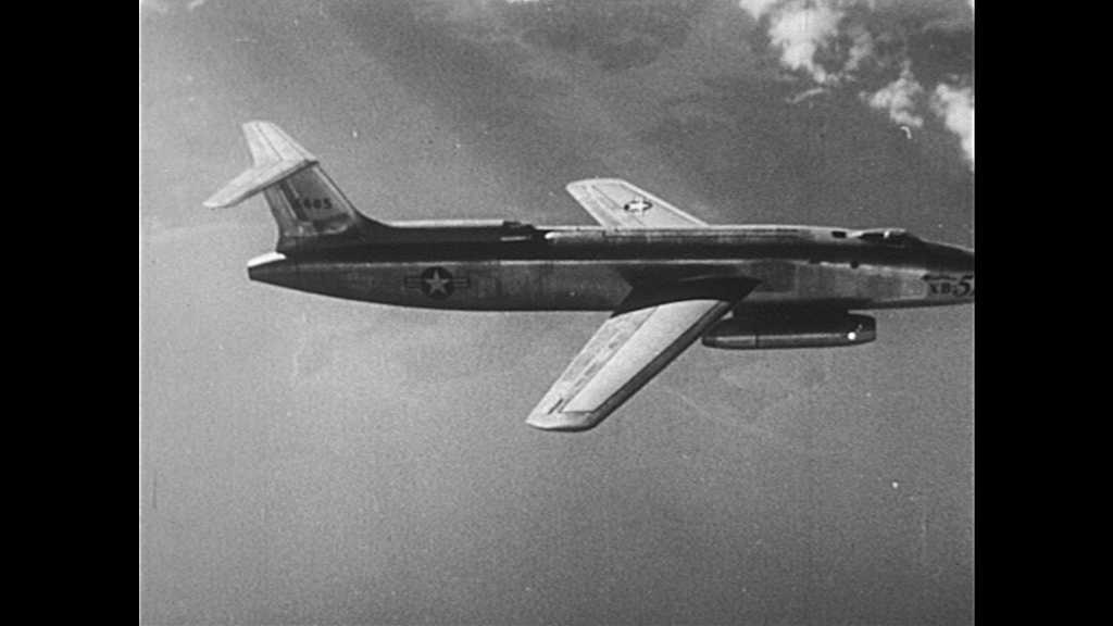 1950s: Jets fly through air. Northrop flying wing takes off, flies. B-47 bomber jet flies through sky.