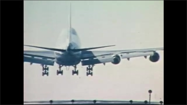 """1980s: Title reads, """"Flying Machines."""" A plane lands. People greet each other happily."""