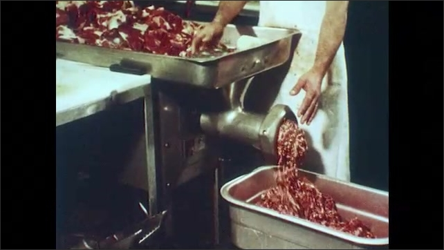 1970s: Sticker on milk can, zoom out to men talking. Cows walk through chute. Mean grinder chops meat. Kids in front of group, put hamburger patty and cheese on model.