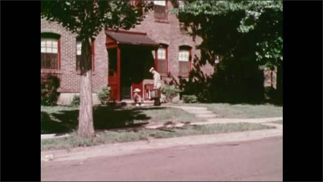 1960s: Soldier looks forlorn in front of mechanic. Woman types at desk as man opens file in file cabinet. Soldier walks up to house carrying a tv. Man enters house as woman irons and sets tv on chair.