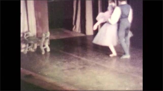 1970s: Ballet dancers.  Musicians sit in orchestra pit.