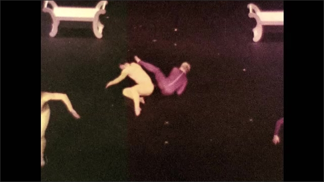 "1970s: Women speak.  Dancers perform on stage.  Poster for ""SHERLOCK HOLMES."""