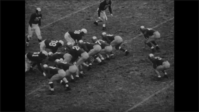 1940s: crowds of fans in stadium cheering, quarterback throws deep pass to receiver who dives to catch, quarterback throws deep pass for touchdown