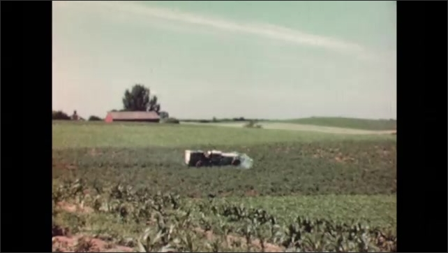 UNITED STATES 1940s: close up of blades cutting hay / man in the middle of a field / vehicle spraying crops