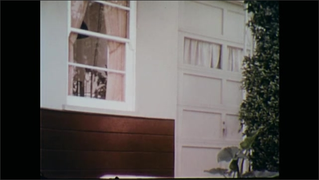 1970s: Policemen exit car, run up to house, peek into window.