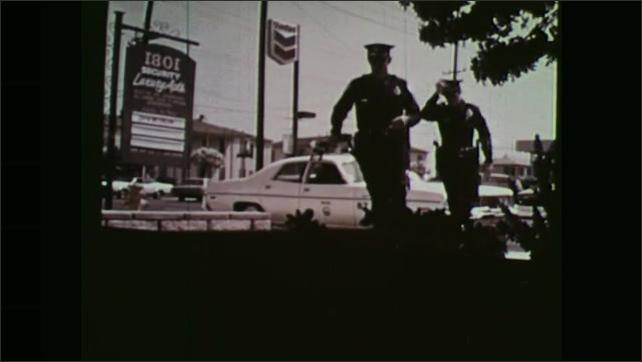 1970s: Officers exit police car, enter building.