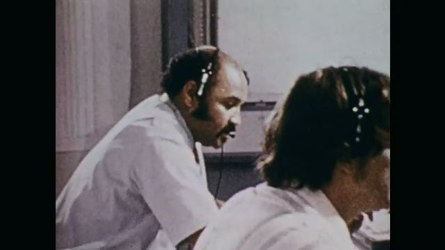 1970s: Meteorology office, men wear headsets, press buttons, operate radar equipment. Radar image, storm drifts across screen. Funnel cloud forms.