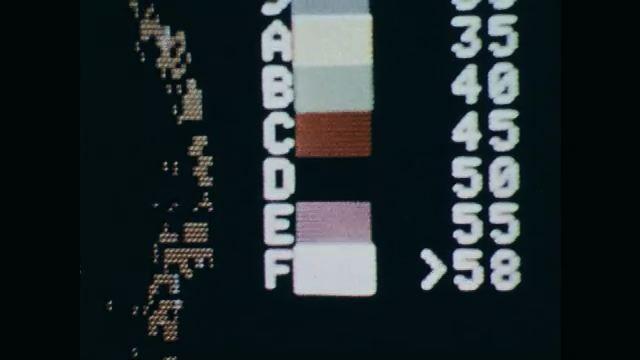 1970s: Doppler radar screen blinks, velocity color key, blue and red areas, tornado.