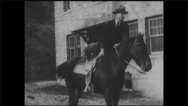 1930s: UNITED STATES: surgeon rides horse along track. Man rides horse to hospital. Man enters building