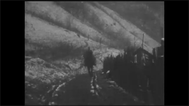 1930s: Woman rides horse through snowy forest. Woman rides horse down dirt road, then dismounts.