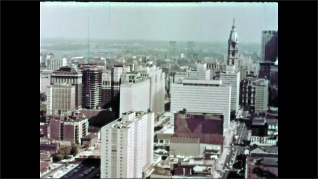 1960s: Flying over downtown city.
