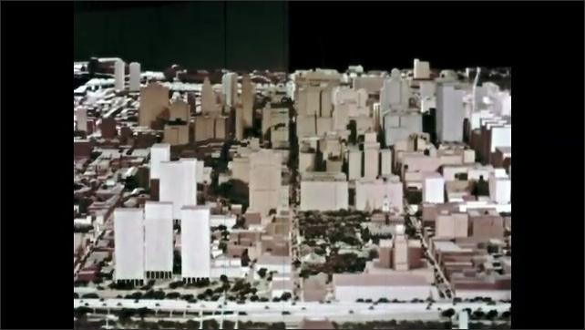 1960s: View of model city, tilt up.