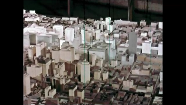 1960s: Tracking shot of scale model of city.